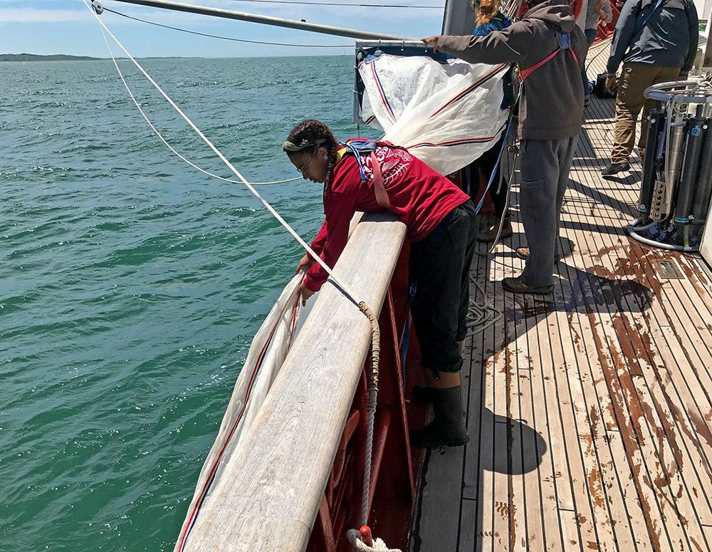 Jaxine Wolfe, NES-LTER REU with the 2019 PEP, deploying neuston net from SEA sailing research vessel Corwith Cramer. Photo courtesy Jaxine Wolfe.